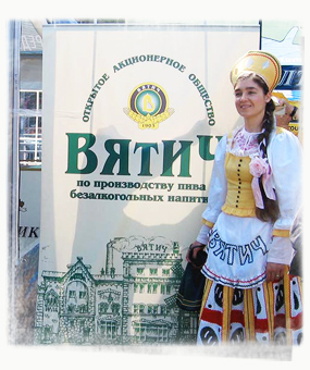OK, I really tried hard to not take any it-takes-girls-to-sell-alcohol photos. But not when they were dressed in such pretty costumes as this Russian one .. - by SL Wong