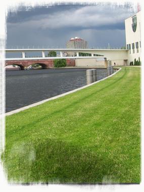 A rainy-gray Spree winding under the Nordbrücke am Bundeskanzleramt. - by SK Mandal