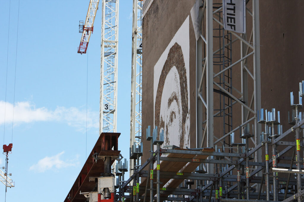 In 2015, the Vhils portrait was completely surrounded by construction material. - <em>S.L. Wong</em>