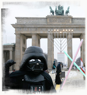 Darth Vader duels with a fan at the Brandenburger Tor. - by SL Wong