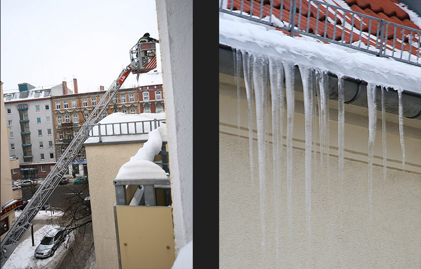 Firemen clearing the lethal icicles hanging from rooftops. - by SL Wong